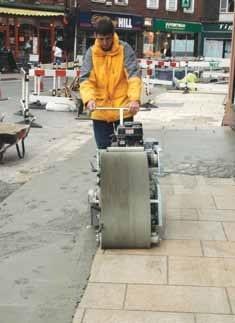 Sponge machine for paving grout
